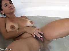 Tori Baker getting off in the bathtub
