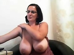 MILF with glasses shows her gigantic boobs