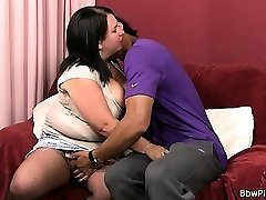Dark-hued street hooker and bbw in fishnets