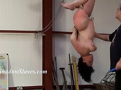 Suspended slaves breast whipping and hardcore slavery