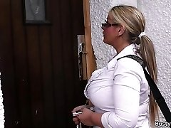 Working blonde plus-size in stockings spreads legs