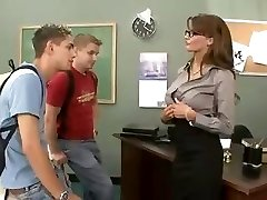Busty dark haired teacher fucks and sucks her two students in threesome