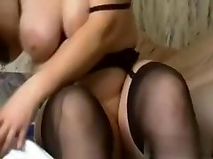 I am this naughty slut with huge amateur mambos, who is wearing high heels, while fucking a massive black dildo.