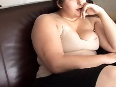 Beautiful buxomy brunette BBW has a soaking wet beaver