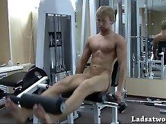 Juvenile straight fellow posing in sport hall
