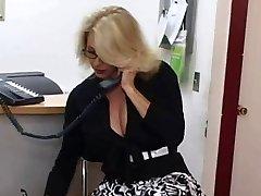 Mature secretary acquires cum on her big tits