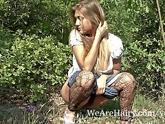 Hairy gal Riana S enjoys her walk outside