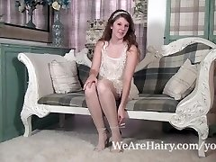 Jada is frisky and wondrous  as she strips on chair