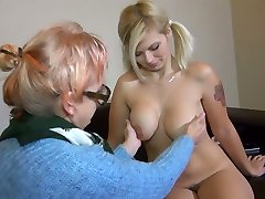 Old ugly bitch in glasses Bernadett tickles fresh pussy of pigtailed buxomy woman