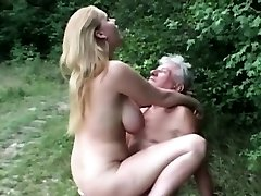 Natural hefty breasted slut fucks grandpa in the woods