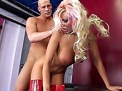 Whore in crimson latex fucks stud by a strap on dildo