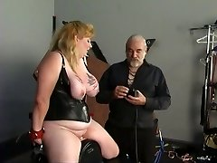 Big orb blonde in leather sucks and rides fake penis with helping of her master