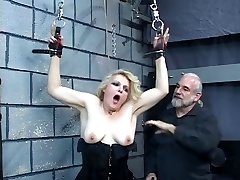 Older blonde milf gets strapped in for some discipline