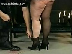 German master hits dirty fat sub in his dungeon on her giant ass with a whip