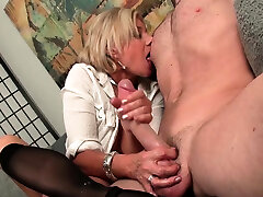 Stockinged mature wanking shaft until cumshot