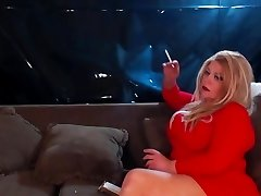 Buxom ash-blonde smoking