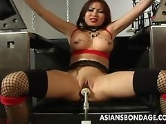 Buxomy brunette getting her moist pussy machine fucked
