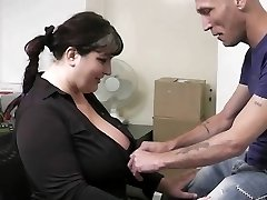 Big-boobed lady in tights rides dick at work