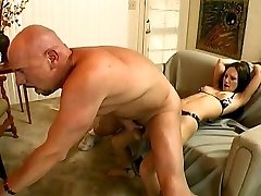 Dude with large cock fuck a nymph on the couch