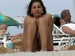A voyeur grabbing pussies and tits of girls on a naked beach