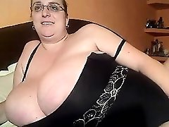 BBW with glasses demonstrates her humungous boobs