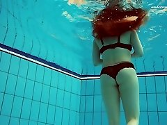 Sumptuous Vesta stripping underwater in titillating solo video