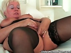 Chubby granny with ginormous tits wears black stockings and drains