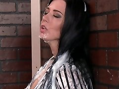 Filthy bitch sucking large sex toy through the gloryhole