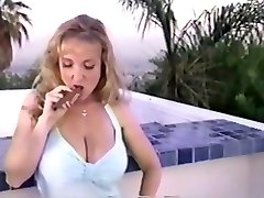 Danni ashe smoking a cigar