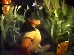 Girl sponge diver swims underwater