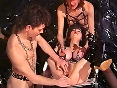 Mature harlot gets her pierced pussy and boobs munched by young guy
