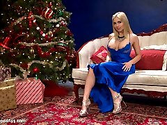 The gorgeous Christie Stevens plays a rich bitch who despises anything Christmas until a ghost of Christmas past visits her to punish her and change her ways. Hot lesbian spanking, pussy licking, dildo gag, bondage and strap-on anal sex all included!