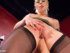 Hot blonde AJ Applegate finds herself under the control of dominatrix Goddess Lorelei Lee. Trapped in her cage, AJ is caned before she's released, only to be flogged and spanked. Lorelei subjects AJ to some erotic humiliation by making her piss in her bondage and all over the floor. Lorelei then shoves AJ's toes and foot up her cunt before fucking her foot to orgasm. Bound and helpless, AJ takes Lorelei's whole fist and comes all over her hand. Finally a good hard lesbian anal strap-on fucking concludes a smoking hot BDSM scene between two gorgeous women!