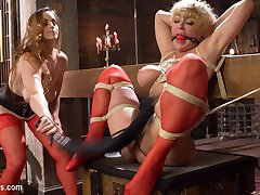 Bella and Darling's mistress leaves them alone in her dungeon, shackled and bound together with a kissing gag. Unsupervised, Bella struggles out of her restraints only to use Darling as her personal lesbian fuck toy. The scene intensifies with spanking, bondage, flogging, caning, pussy licking, ass worship, finger banging, pussy and anal strap-on and relentless orgasm torture!