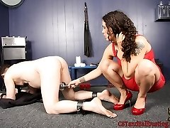 Zayda locks her male slave on his knees and elbows into a metal stock. With him properly...