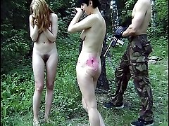 Two naked girls in the forest hunted down and severely punished
