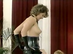 Hussy mistress in latex outfit gives inhale blowjob