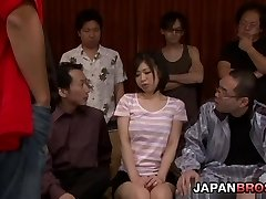 Yuuka Tsubasa in a good-sized gangbang swallows cum from a glass
