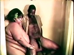 Ginormous fat gigantic black bitch enjoys a hard black cock between her lips and legs