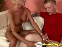 Jerking granny gets some juices from a midget