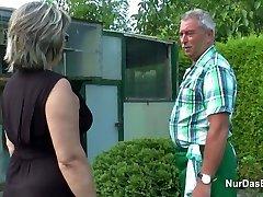 German Grandpa and Grandma pulverize Rigid in Garden