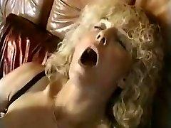 Granny inserts large dildo