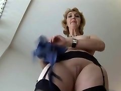 Mature English blonde stunner in stockings upskirt taunt