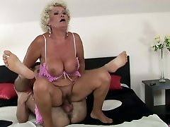 Enormous curly oldie sucks a strong fresh prick in position 69 to be fed with cum