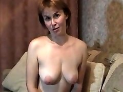 Light-haired mature milf at home stripteasing and frigging her pussy