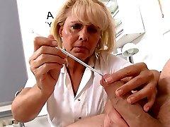 Mature Blond Nurse measures patients penis gentle and erect