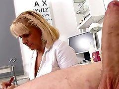 Mature Blonde Nurse measures patients penis mild and erect