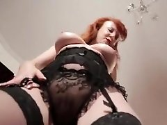 Busty mature redhead domina plays with her pussy close up