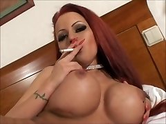 Sexy big tit smoking redhead masturbating