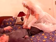 The youthful groom pummel his mature grown bride!